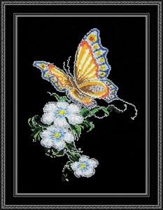 Изображение Бабочка на цветке