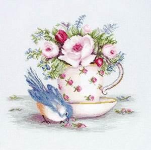 Изображение Птичка и чашка чая