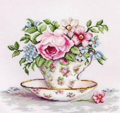 Изображение Цветы в чайной чашке